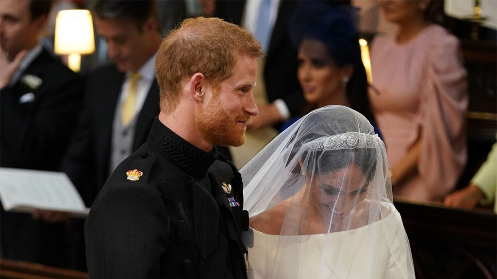 WINDSOR, UNITED KINGDOM - MAY 19: Prince Harry and Meghan Markle stand together in St George's Chapel at Windsor Castle for their wedding on May 19, 2018 in Windsor, England.